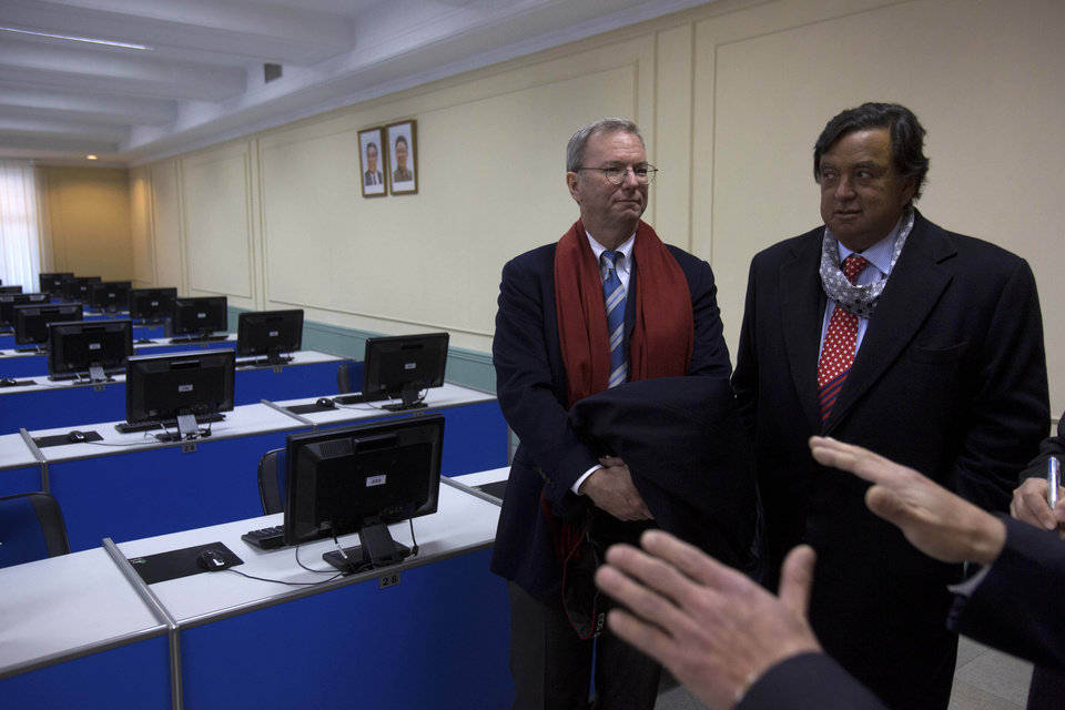 Photo - Executive Chairman of Google, Eric Schmidt, left, and former New Mexico governor Bill Richardson tour a computer lab at Kim Il Sung University in Pyongyang, North Korea on Tuesday, Jan. 8, 2013. Schmidt is the highest-profile U.S. executive to visit North Korea-a country with notoriously restrictive online policies-since young leader Kim Jong Un took power a year ago. (AP Photo/David Guttenfelder)