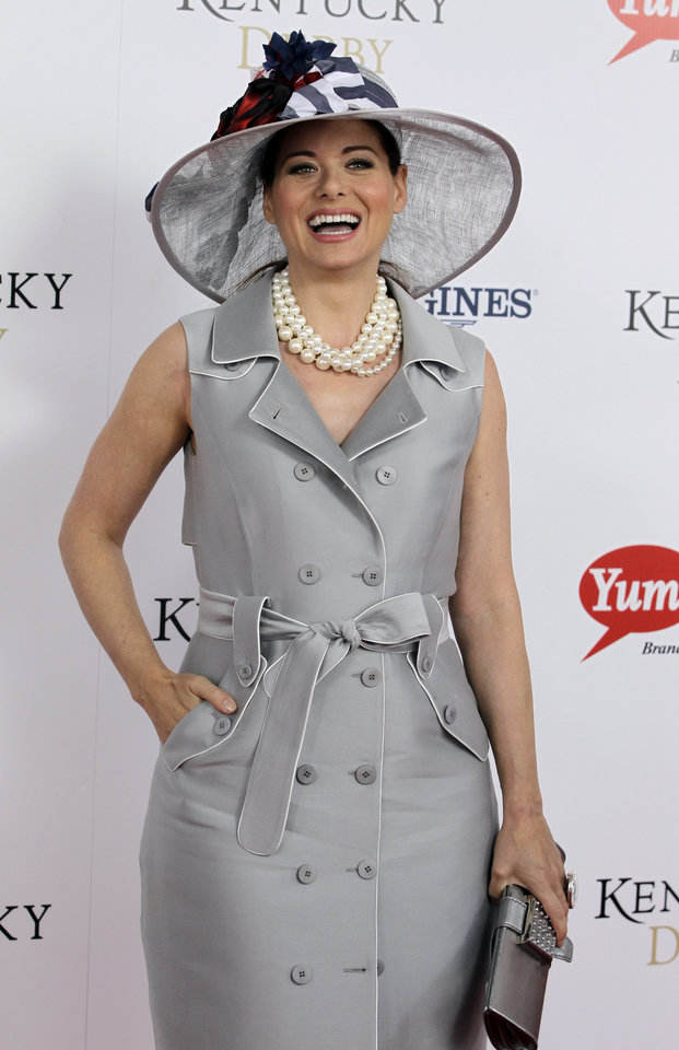 "Actress Debra Messing, star of ""Will & Grace"" arrives for the 138th Kentucky Derby horse race at Churchill Downs Saturday, May 5, 2012, in Louisville, Ky. (AP Photo/Darron Cummings)  ORG XMIT: DBY161"