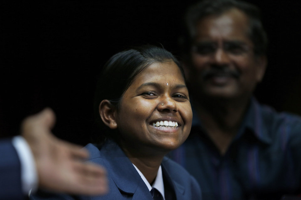Photo - Malavath Poorna, from the southern Indian state of Andhra Pradesh smiles as she addresses a press conference in New Delhi, India, Wednesday, June 4, 2014. A social charity says the 13-year-old daughter of poor Indian farmers has become the youngest girl to climb Mount Everest. Poorna says she and a team of Nepalese climbing guides made it to the top on May 25 from the northern side in Tibet. (AP Photo/Saurabh Das)