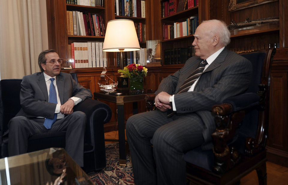 Photo -   Greek President Karolos Papoulias, right, meets with conservative election winner Antonis Samaras, to formally give him the mandate to form a coalition government, in Athens on May 7, 2012. Greek conservative leader Antonis Samaras, whose pro-austerity party came first in national elections but fell well short of a governing majority, is currently trying to form a new coalition government. Samaras has three days in which to build an alliance, after receiving the formal mandate from President Karolos Papoulias Monday. (AP Photo/Aris Messinis, pool)