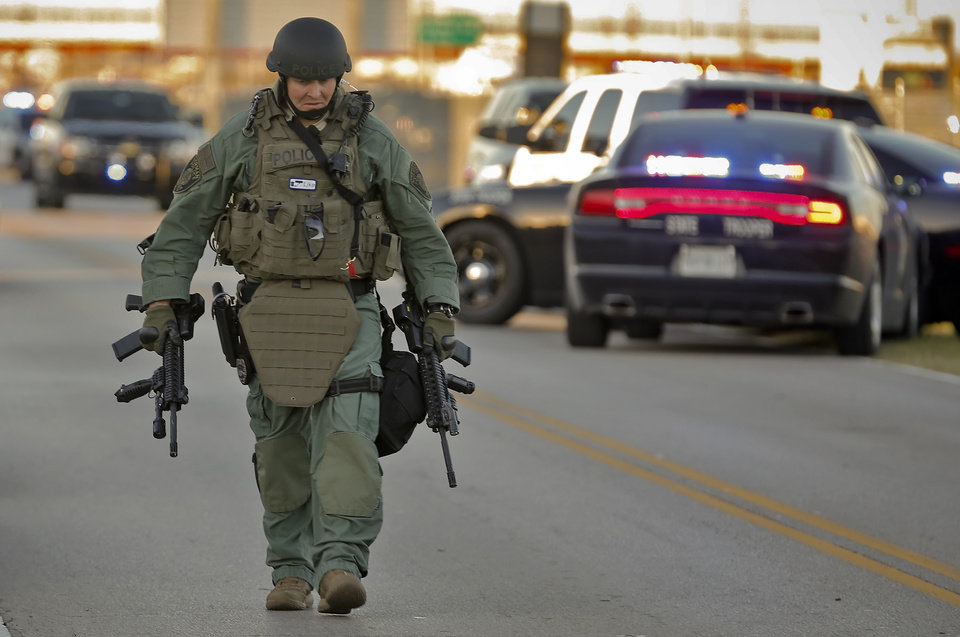 Photo - Swat team members clear the scene of a hostage situation at Nextep in Norman Monday, Nov. 10, 2014.  in Norman, Okla. on Monday, Nov. 10, 2014.  Photo by Chris Landsberger, The Oklahoman