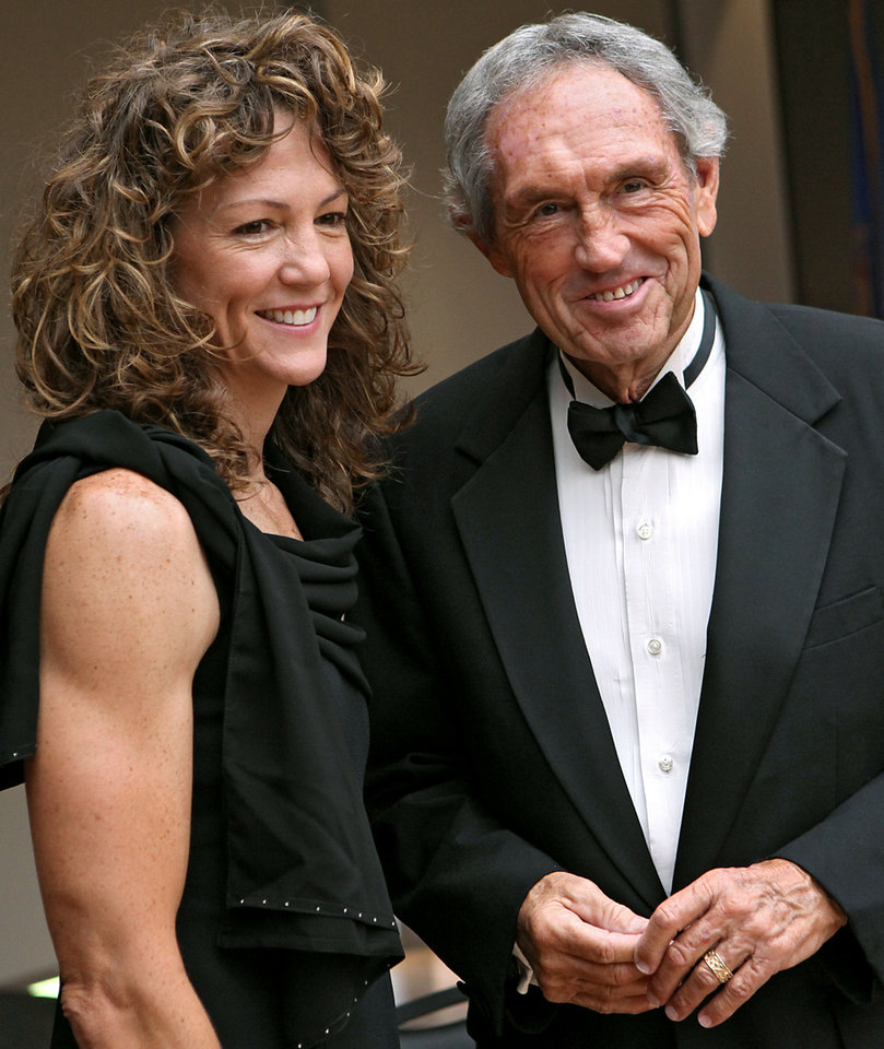 Michele Smith and former Oklahoma State University (OSU) college basketball head coach Eddie Sutton pose for a photograph during a reception at the Jim Thorpe Museum and Oklahoma Sports Hall of Fame in Oklahoma City on Tuesday, August 3, 2010. Photo by John Clanton, The Oklahoman <strong>John Clanton - The Oklahoman</strong>