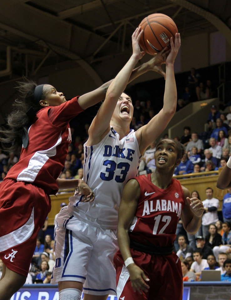 Photo - Duke's Haley Peters (33) goes up for a shot between Alabama defenders Daisha Simmons, left, and Shafontaye Myers (12) during the first half of an NCAA college basketball game in Durham, N.C., Sunday, Nov. 17, 2013.  Duke led at halftime 47-24.  (AP Photo/Ted Richardson)