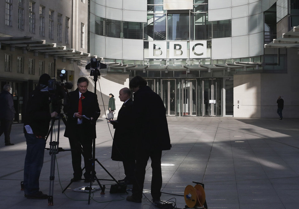 Photo -   A television crew set up for alive transmission outside the BBC headquarters in London, Sunday, Nov, 11, 2012. The head of the BBC's governing body said Sunday the broadcaster needs a radical overhaul following the resignation of its chief executive in wake of a scandal over a botched report on child sex-abuse allegations. Chris Patten vowed to restore confidence and trust in the BBC, which is reeling from the resignation of George Entwistle and the scandals prompting his ouster. Entwistle resigned Saturday night amid a storm of controversy after a news program wrongly implicated a British politician in a child sex-abuse scandal, deepening a crisis sparked by revelations it decided not to air similar allegations against one of its own stars.(AP Photo/Alastair Grant)