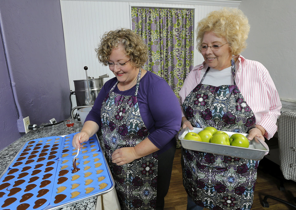 Photo -  Imalee Crow, right, and her daughter Annette Gunter work in their Bethany confection business. They prepare and sell signature fudge in several flavors. Photo by Jim Beckel, The Oklahoman   Jim Beckel -