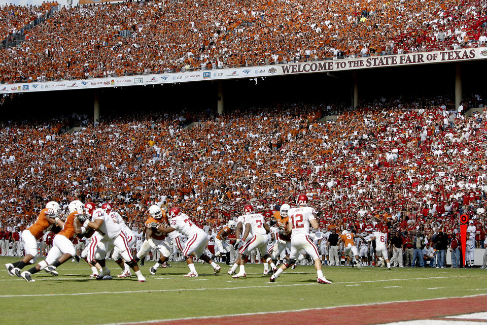 Photo - Fans watch during the Red River Rivalry college football game between the University of Oklahoma Sooners (OU) and the University of Texas Longhorns (UT) at the Cotton Bowl in Dallas, Texas, Saturday, Oct. 17, 2009. Photo by Bryan Terry, The Oklahoman