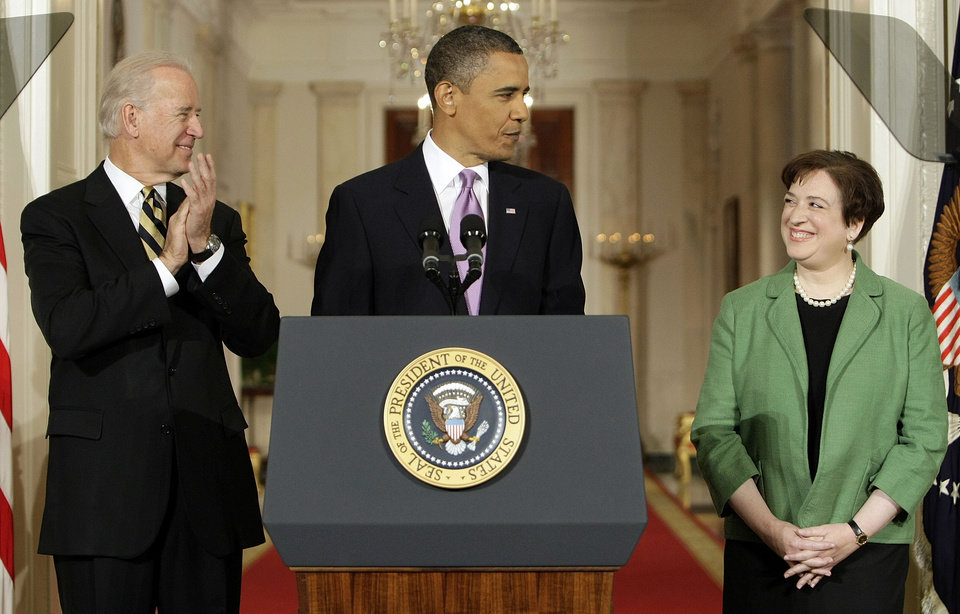Photo - SUPREME COURT JUSTICE NOMINEE: President Barack Obama introduces Solicitor General Elena Kagan as his choice for Supreme Court Justice in the East Room of the White House in Washington, Monday May 10, 2010 as Vice President Joe Biden applauds. (AP Photo/J. Scott Applewhite) ORG XMIT: WHDA111