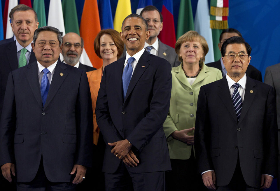 Photo -   President Barack Obama takes his place with other leaders for the Family Photo during the G20 Summit, Monday, June 18, 2012, in Los Cabos, Mexico. From left, Turkish Prime Minister Recep Tayyip Erdogan, Indonesian President Susilo Bambang Yudhoyono, Jose Graziano da Silva, Australian Prime Minister Julia Gillard, U.S. President Barack Obama, Spanish Prime Minister Mariano Rajoy, German Chancellor Angela Merkel, Chinese President Hu Jintao. (AP Photo/Carolyn Kaster)
