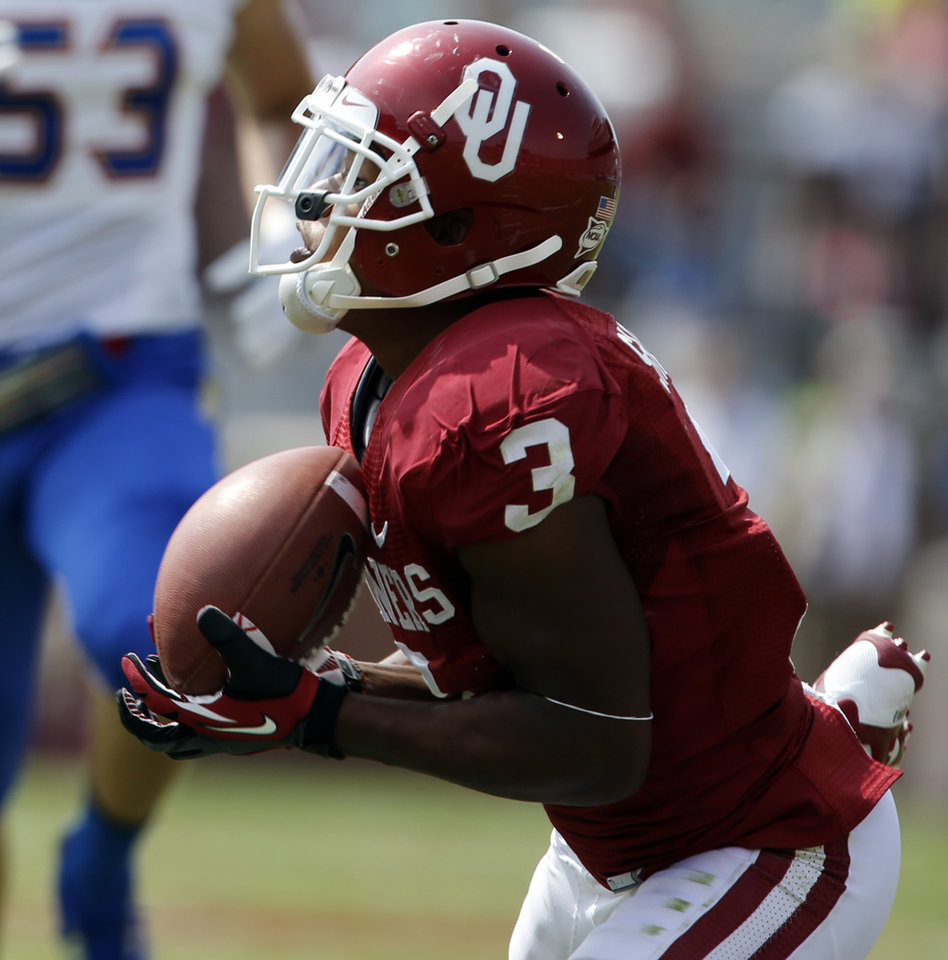Photo - Oklahoma's Sterling Shepard (3) catches a Blake Bell pass during a college football game between the University of Oklahoma Sooners (OU) and the Tulsa Golden Hurricane (TU) at Gaylord Family-Oklahoma Memorial Stadium in Norman, Okla., on Saturday, Sept. 14, 2013. Photo by Steve Sisney, The Oklahoman