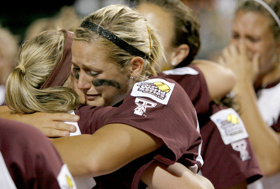 Photo - COLLEGE SOFTBALL: Texas A&M's Megan Gibson hugs a teammate after their loss in the final championship game of the Women's College World Series between Texas A&M University and Arizona State University at ASA Hall of Fame Stadium in Oklahoma City, Tuesday, June 3, 2008. BY BRYAN TERRY, THE OKLAHOMAN ORG XMIT: KOD