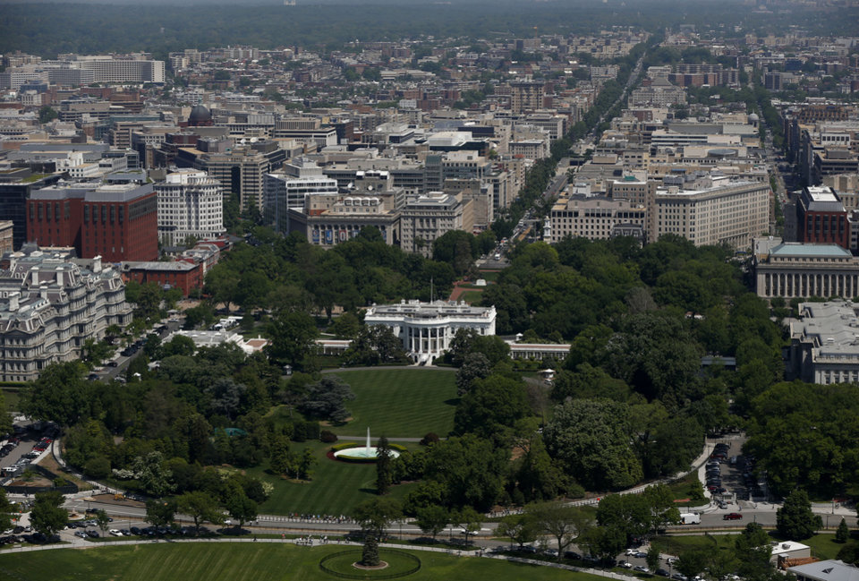 Photo - The South Lawn and the White House are seen from the 500-foot level of the Washington Monument in Washington, Monday, May 12, 2014, as it re-opens. The monument, which sustained damage from an earthquake in August 2011, reopened to the public today. (AP Photo)