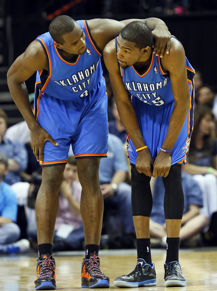 Oklahoma City's Serge Ibaka (9) checks on Kevin Durant (35) after his face was hit during Game 3 in the second round of the NBA basketball playoffs between the Oklahoma City Thunder and Memphis Grizzles at the FedExForum in Memphis, Tenn., Saturday, May 11, 2013. Memphis won, 87-81. Photo by Nate Billings, The Oklahoman