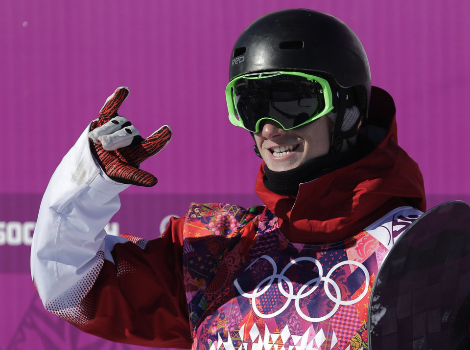 Photo - Canada's Maxence Parrot reacts after a run during the men's snowboard slopestyle qualifying at the Rosa Khutor Extreme Park ahead of the 2014 Winter Olympics, Thursday, Feb. 6, 2014, in Krasnaya Polyana, Russia.  (AP Photo/Andy Wong)