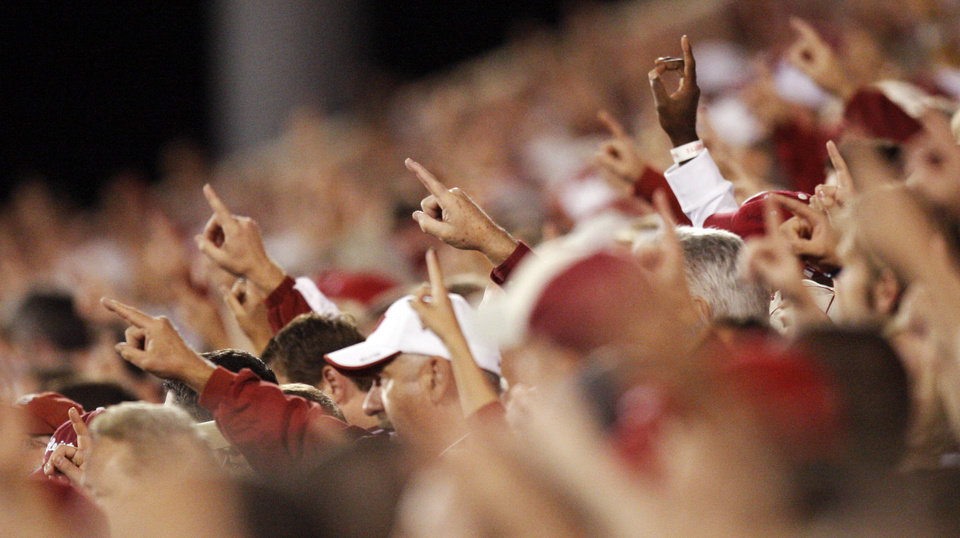 Photo - Fans raise their fingers during the singing of the