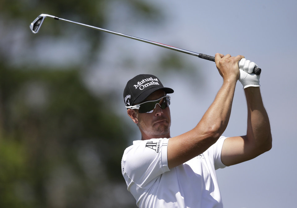 Photo - Henrik Stenson of Sweden hits from the 14th tee during the second round of the Cadillac Championship golf tournament Friday, March 7, 2014, in Doral, Fla. (AP Photo/Wilfredo Lee)
