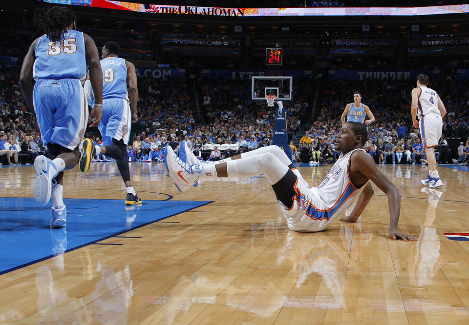 Oklahoma City's Kevin Durant (35) falls during the NBA preseason basketball game between the Oklahoma City Thunder and the Denver Nuggets at the Chesapeake Energy Arena, Sunday, Oct. 21, 2012. Photo by Garett Fisbeck, The Oklahoman