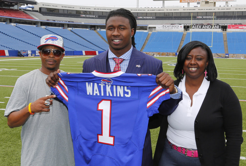 Photo - Buffalo Bills first round draft pick Sammy Watkins poses for photos with his father James McMiller, left, and mother Nicole McMiller at Ralph Wilson Stadium in Orchard Park, N.Y., Friday, May 9, 2014. (AP Photo/Bill Wippert)