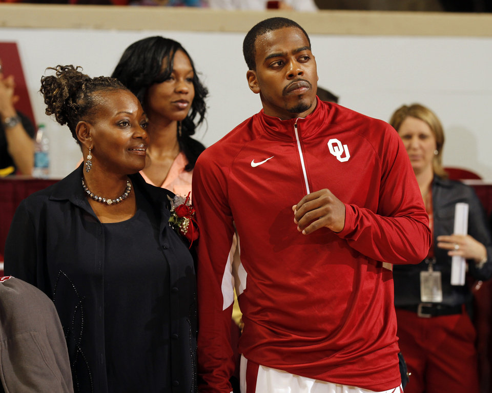 Photo - Sam Grooms and his family are introduced before the game on Senior Day as the University of Oklahoma Sooners (OU) men play the Iowa State Cyclones in NCAA, college basketball at Lloyd Noble Center on Saturday, March 2, 2013  in Norman, Okla. Photo by Steve Sisney, The Oklahoman