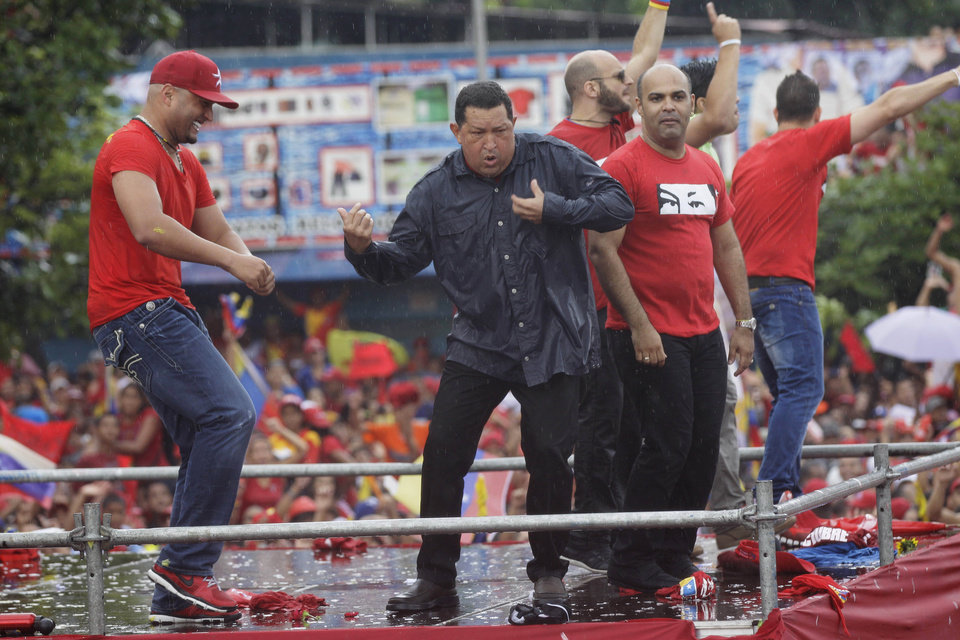 Venezuela's President Hugo Chavez, second from right, dances after delivering a speech during his closing campaign rally in Caracas, Venezuela, Thursday, Oct. 4, 2012. Chavez is running for re-election against opposition candidate Henrique Capriles in presidential elections on Oct . 7. (AP Photo/Ariana Cubillos)