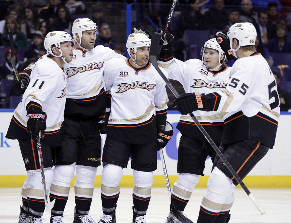 Anaheim Ducks' Andrew Cogliano (7), center, is congratulated by teammates after scoring a goal in the first period of an NHL hockey game against the St. Louis Blues, Saturday, Dec. 7, 2013, in St. Louis. (AP Photo/Tom Gannam)
