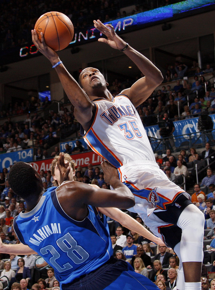 Oklahoma City\'s Kevin Durant (35) moves to the hoop against Dallas\' Ian Mahinmi (28) during the NBA basketball game between the Oklahoma City Thunder and the Dallas Mavericks at Chesapeake Energy Arena in Oklahoma City, Monday, March 5, 2012. The Thunder won, 95-91. Photo by Nate Billings, The Oklahoman