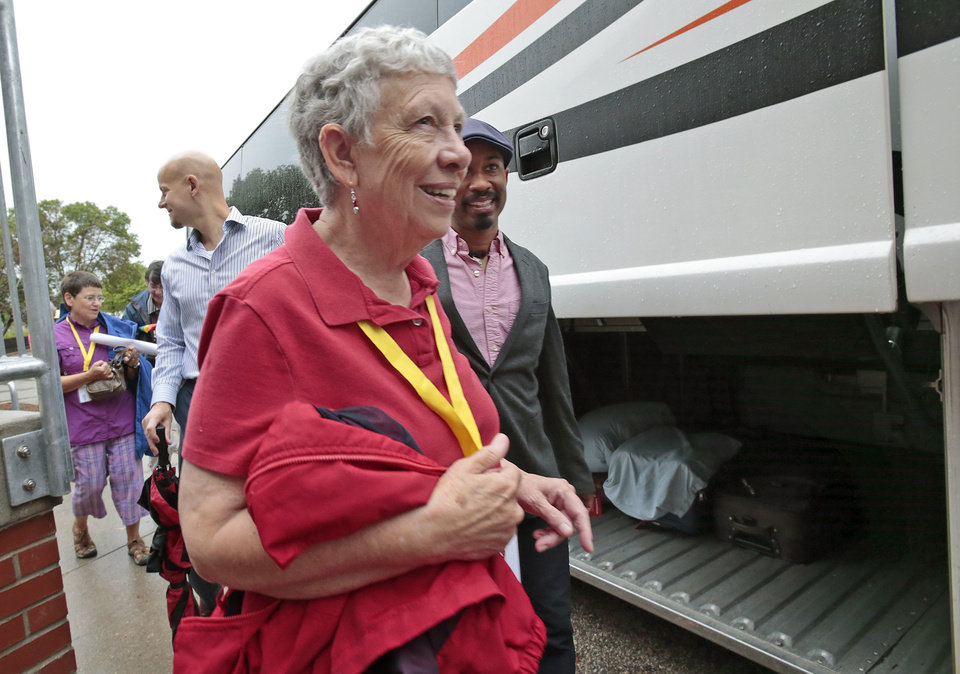 Photo - Virginia Wolf, one of several named plaintiffs in Wolf v. Walker which challenges Wisconsin's ban on same-sex marriage, walks with fellow plaintiffs to a bus during Wisconsin Unites for Marriage's Marriage Bus Tour stop at the South Central LGBT Community Center in Madison, Wis., Monday, Aug. 25, 2014. The bus continues on to Milwaukee, Racine and then Chicago Monday afternoon for a rally at Federal Plaza. On Tuesday, the 7th Circuit Court of Appeals in Chicago will hear arguments in challenges to Wisconsin and Indiana's same-sex marriage bans. (AP Photo/Wisconsin State Journal, M.P. King)