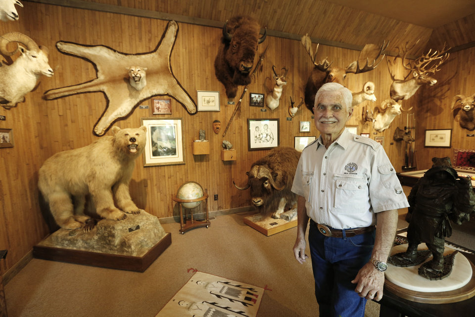 Photo - Bill Lockard in his trophy room at his home in Oklahoma City, Wednesday July 31, 2013. Photo By Steve Gooch, The Oklahoman