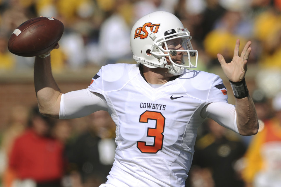 Photo - Oklahoma State quarterback Brandon Weeden throws during the first half of an NCAA college football game against Missouri Saturday, Oct. 22, 2011, in Columbia, Mo. (AP Photo/L.G. Patterson)