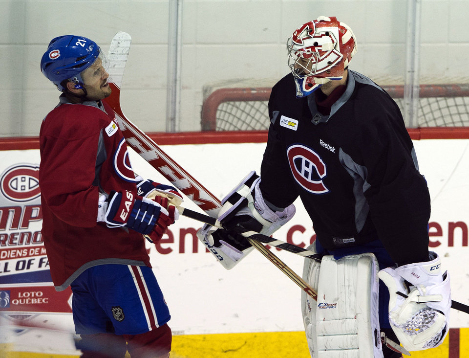 Photo - Montreal Canadiens goaltender Carey Price jokes with Brian Gionta, left, during NHL hockey practice, Monday, April 29, 2013, in Brossard, Quebec. Montreal is scheduled to play the Ottawa Senators in the first round of the Stanley Cup playoffs starting with Game 1 on Thursday. (AP Photo/The Canadian Press, Ryan Remiorz)