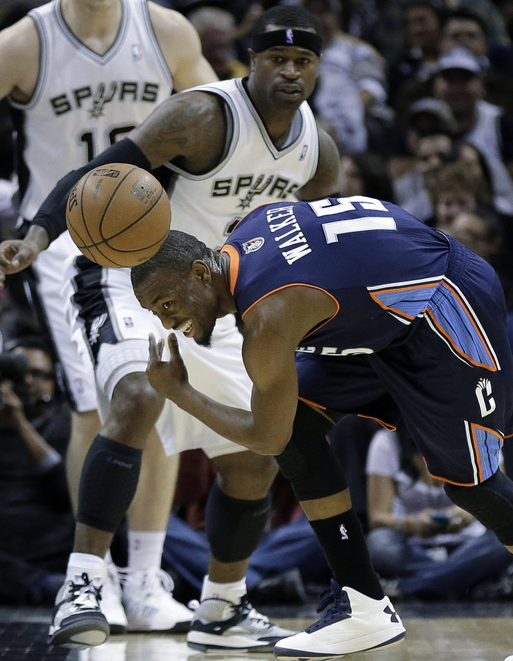 Charlotte Bobcats' Kemba Walker (15) loses control of the ball against San Antonio Spurs' Stephen Jackson, left, during the first half of an NBA basketball game, Wednesday, Jan. 30, 2013, in San Antonio. (AP Photo/Eric Gay)