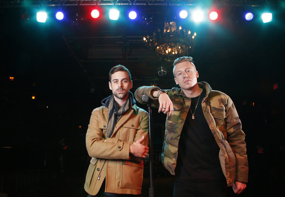 FILE - In this Nov. 20, 2012 file photo, American musician Ben Haggerty, better known by his stage name Macklemore, right, and his producer Ryan Lewis pose for a portrait at Irving Plaza in New York. Macklemore & Ryan Lewis feat. Wanz,