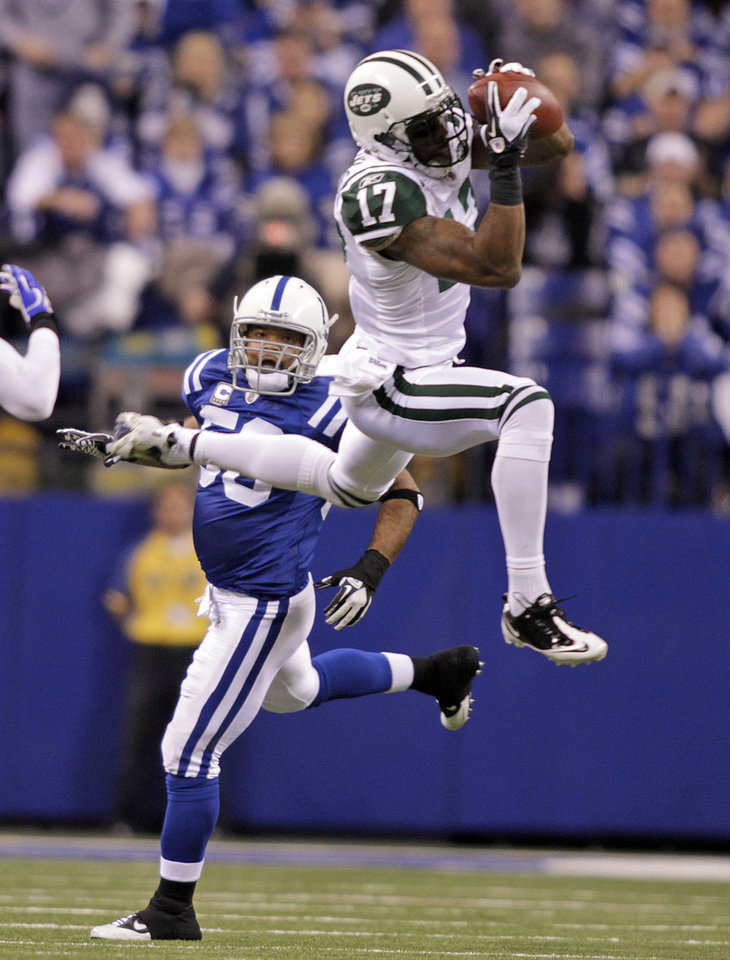 FILE - In this Jan. 8, 2011, file photo, New York Jets wide receiver Braylon Edwards (17) makes a catch while being defended by Indianapolis Colts linebacker Gary Brackett (58) during the second quarter of an NFL AFC wild card football playoff game in Indianapolis. Edwards is back on the field with the New York Jets, and is expected to play against the Tennessee Titans on Monday night.  Edwards was claimed off waivers from Seattle on Tuesday.  (AP Photo/AJ Mast, File)