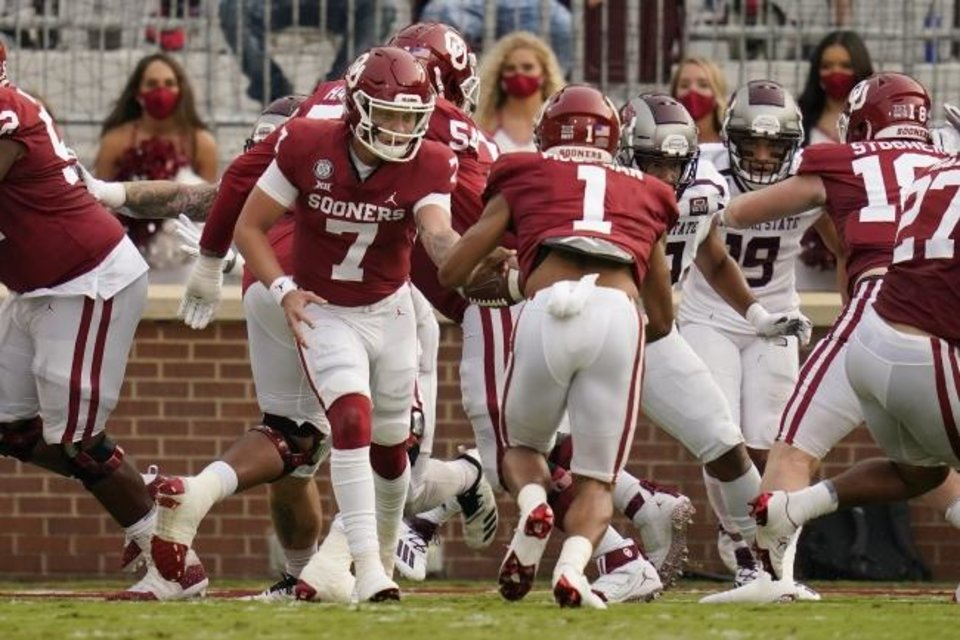 Photo -  OU quarterback Spencer Rattler (7) hands off to Seth McGowan (1) who takes the ball in for a touchdown against Missouri State on Saturday. [AP Photo/Sue Ogrocki]