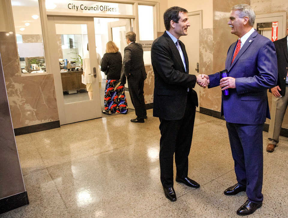 Photo - Ward 2 Councilman Ed Shadid, left, speaks to Chris Browning during a reception that precedes Shadid's last council meeting at City Hall in Oklahoma City, Okla. on Tuesday, March 26, 2019.  Sahadid did not seek re-election after serving eight years on the council.  Photo by Chris Landsberger, The Oklahoman