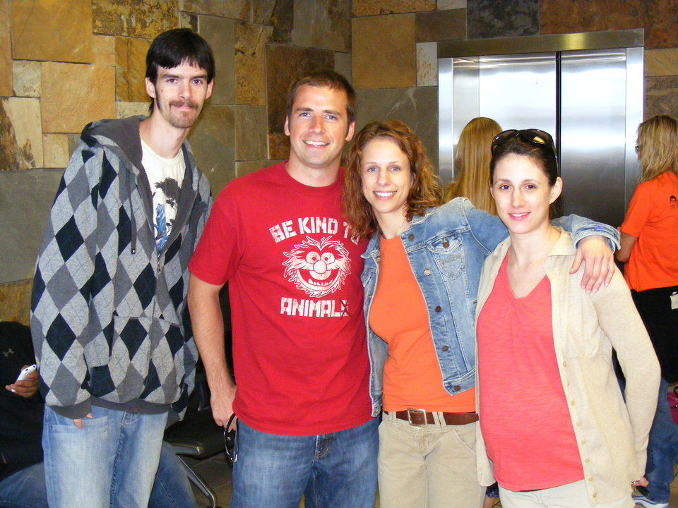 Photo - Tatyana Golubeva, second from right, is shown at Will Rogers World Airport with her co-workers  before she had to get on a plane to return to Russia. Also in the photo are Luke Southern, Jon Oxtoby and Crystal Howard, who all report to Golubeva. Photo provided