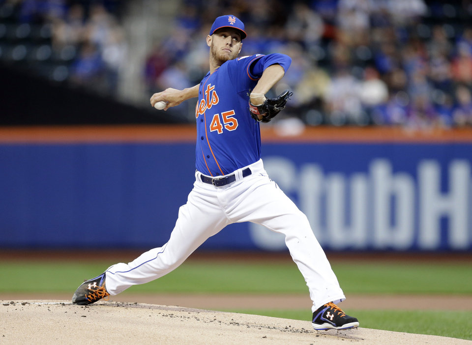 Photo - New York Mets' Zack Wheeler delivers a pitch during the first inning of a baseball game against the Chicago Cubs, Friday, Aug. 15, 2014, in New York. (AP Photo/Frank Franklin II)