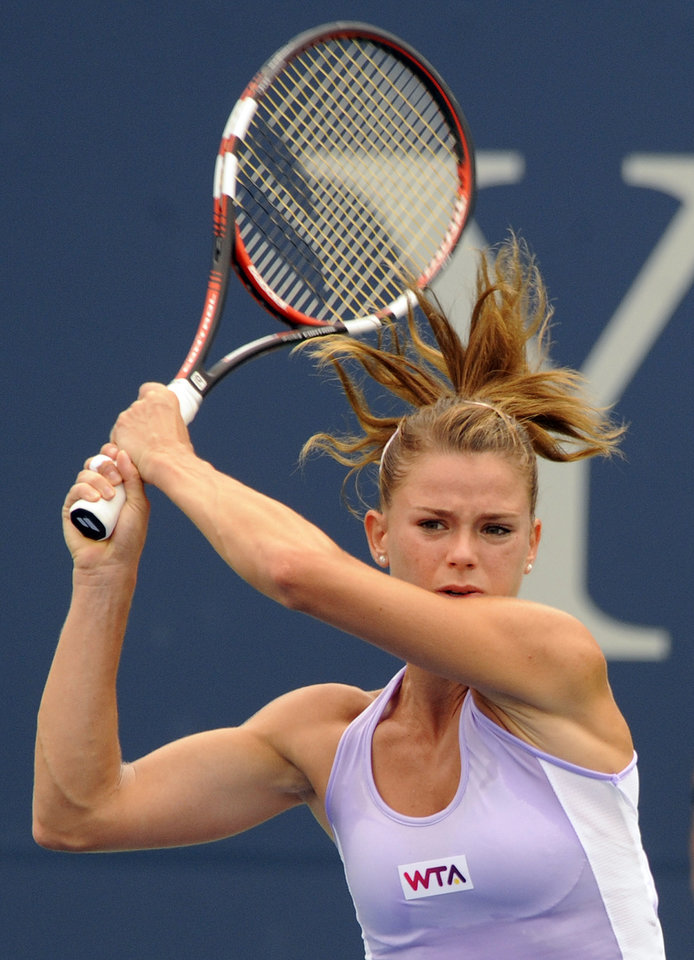 Photo - Camila Giorgi, of Italy, watches her backhand during her 6-2, 6-4 semifinal loss to Magdalena Rybarikova, of Slovakia, at the New Haven Open tennis tournament in New Haven, Conn., on Friday, Aug. 22, 2014. (AP Photo/Fred Beckham)