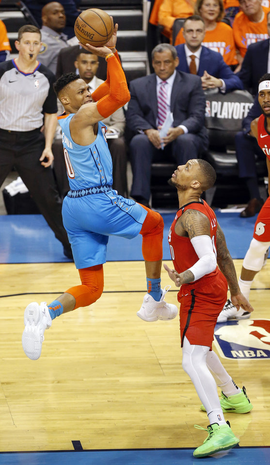 Photo - Oklahoma City's Russell Westbrook (0) takes and makes a shot after being fouled by Portland's Damian Lillard (0) in the third quarter during Game 3 in the first round of the NBA playoffs between the Portland Trail Blazers and the Oklahoma City Thunder at Chesapeake Energy Arena in Oklahoma City, Friday, April 19, 2019. Photo by Nate Billings, The Oklahoman