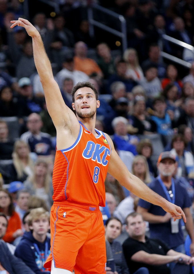 Photo - Oklahoma City's Danilo Gallinari (8) reacts after a 3-point basket during the NBA game between the Oklahoma City Thunder and the Milwaukee Bucks at Chesapeake Energy Arena,   Sunday, Nov. 10, 2019.  [Sarah Phipps/The Oklahoman]