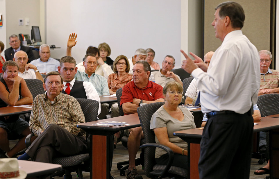 Photo - A crowd listens to Rep. Tom Cole, R-Moore, during a town hall meeting at Rose State College in Midwest City, Tuesday, September 3, 2013. Photo by Bryan Terry, The Oklahoman  BRYAN TERRY - THE OKLAHOMAN