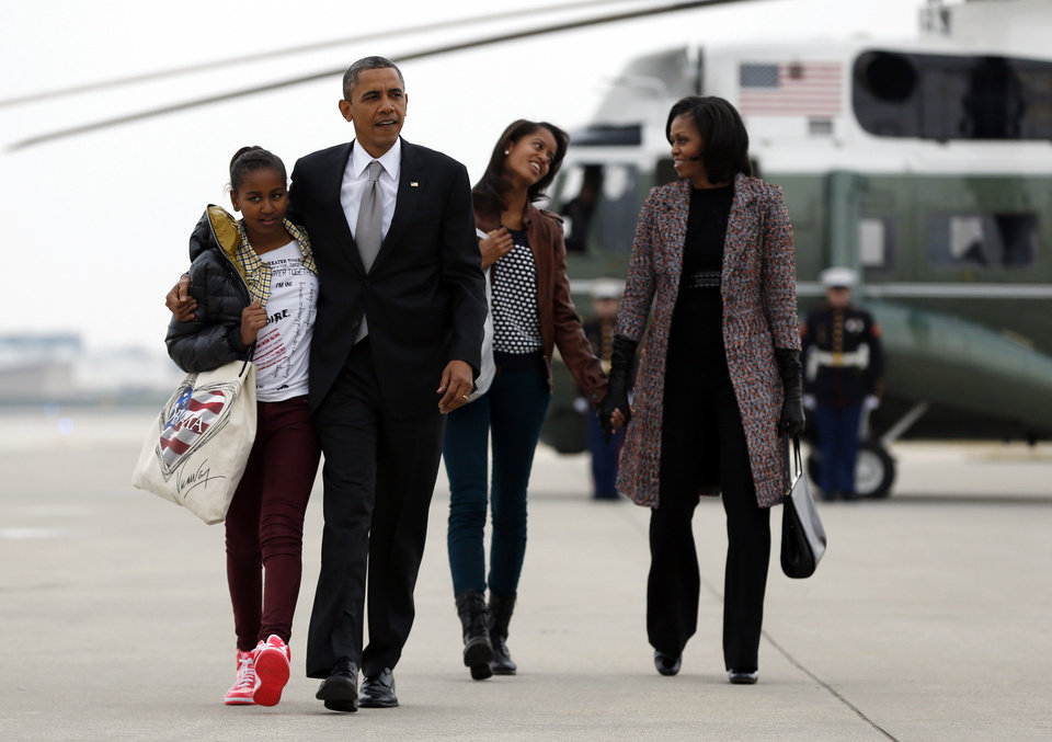 President Barack Obama, first lady Michelle Obama and their daughters Sasha and Malia, walk from Marine One to board Air Force One at Chicago O\'Hare International Airport, Wednesday, Nov. 7, 2012, in Chicago, the day after the presidential election. Obama defeated Republican challenger former Massachusetts Gov. Mitt Romney. (AP Photo/Carolyn Kaster)