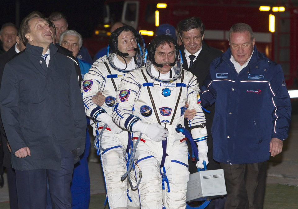 Russian Cosmonauts Alexander Misurkin, left, and Pavel Vinogradov, crew members of the mission to the International Space Station (ISS), walk to the rocket prior the launch of Soyuz-FG rocket at the Russian leased Baikonur Cosmodrome, Kazakhstan, Thursday, March 28, 2013. (AP Photo/ Shamil Zhumatov, Pool)