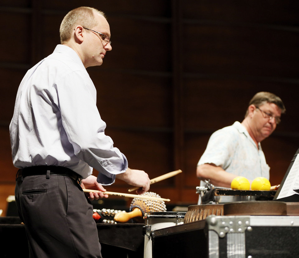 "David Steffens, left, and Roger Owens rehearse ""Ogoun Badagris,"" a work for percussion ensemble.   Photo by Nate Billings, The Oklahoman <strong>NATE BILLINGS - NATE BILLINGS</strong>"