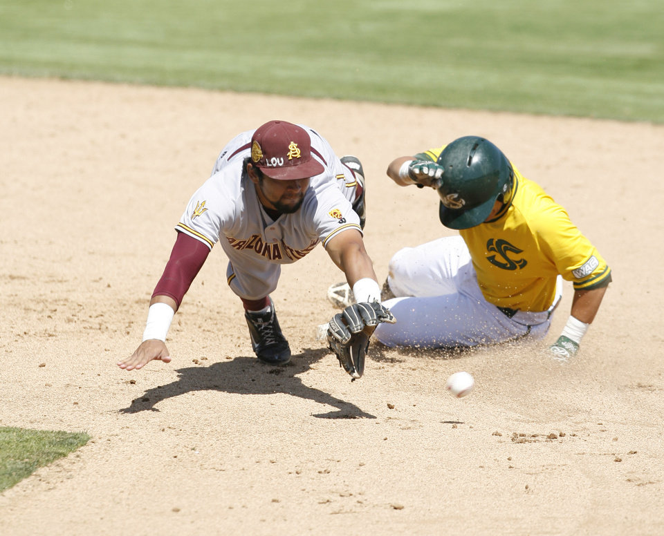 Photo - Arizona State shortstop Drew Stankiewicz, left, dives for a ball thrown from the outfield as Sacramento State's Will Soto slides safely into second during the eighth inning of an NCAA college baseball tournament regional game on Saturday, May 31, 2014, in San Luis Obispo, Calif. (AP Photo/Aaron Lambert)