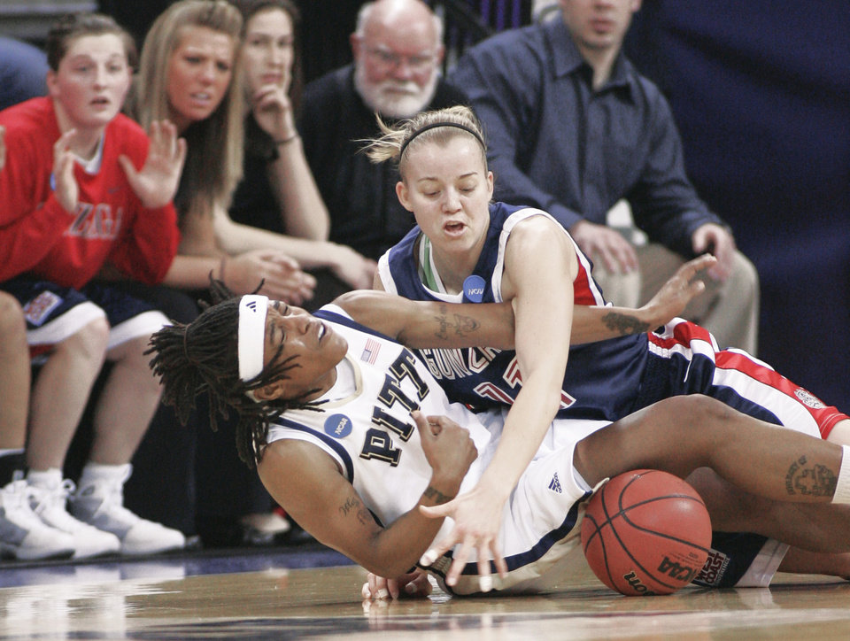 Photo - Pittsburgh's Shavonte Zellous, left, and Gonzaga's Janelle Bekkering battle for a loose ball during the first half Monday. AP PHOTO