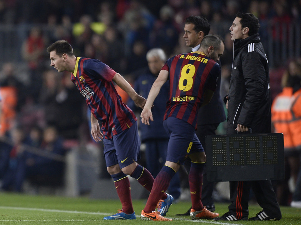 Photo - FC Barcelona's Lionel Messi, from Argentina, left, enters  the pitch  substituting Andres Iniesta, second right, against Getafe during a Copa del Rey soccer match at the Camp Nou stadium in Barcelona, Spain, Wednesday, Jan. 8, 2014. (AP Photo/Manu Fernandez)