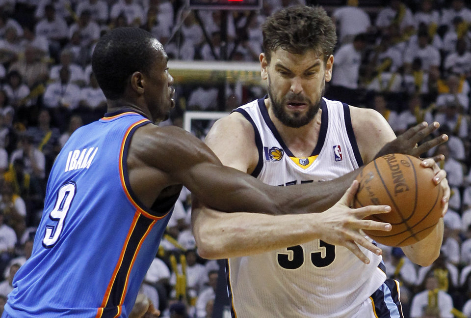 Memphis Grizzlies center Marc Gasol (33), of Spain, drives against Oklahoma City Thunder forward Serge Ibaka (9) during the second half of Game 4 of a second-round NBA basketball playoff series on Monday, May 9, 2011, in Memphis, Tenn. (AP Photo/Lance Murphey)