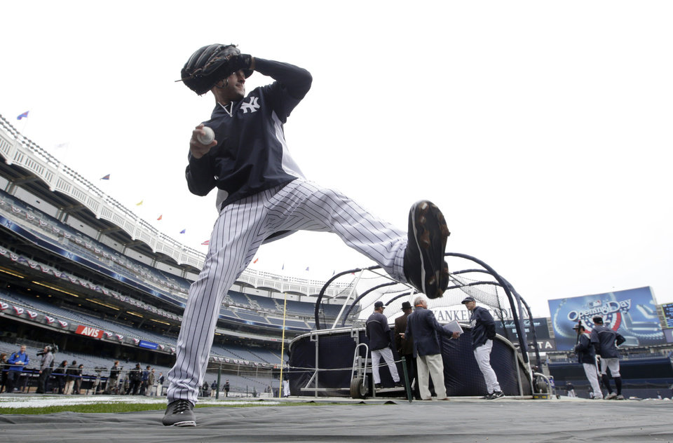 Photo - New York Yankees shortstop Derek Jeter warms up on the field before the Yankees home opener baseball game against the Baltimore Orioles, at Yankee Stadium in New York, Monday, April 7, 2014.  (AP Photo/Kathy Willens)