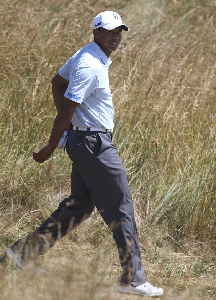 Tiger Woods of the United States walks to the 12th tee during the second round of the British Open Golf Championship at Muirfield, Scotland, Friday July 19, 2013. (AP Photo/Scott Heppell)