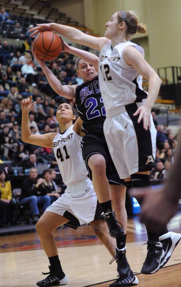 Photo - Army's Olivia Schretzman (12) blocks the shot of Holy Cross' Alex Smith (22) as Army's Brianna Johnson (41) also defends during the first half of an NCAA college basketball game in the Patriot League Championship at Christi Arena, Saturday, March 15, 2014, at West Point, N.Y. (AP Photo/Karl Rabe)